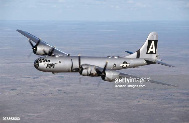 Boeing B29 Super Fortress named 'FiFi' flying over a desert landscape