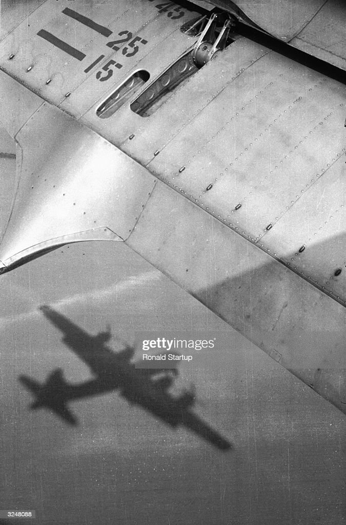 A Boeing B-29 Superfortress casts a shadow on the ground some 800 feet below, during RAF manoeuvres over Germany. Original Publication: Picture Post - 6564 - RAF Manoeuvres Over Germany - unpub.