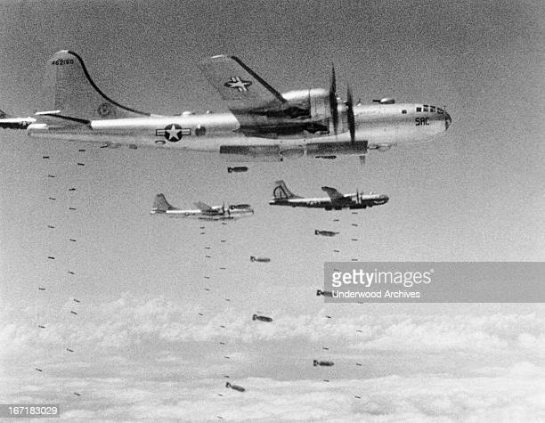 Boeing B29 Superfortresses dropping bombs during a raid on a chemical plant in Komandong Komandong Korea August 14 1950