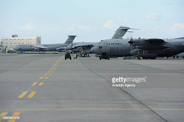 Boeing C17 Globemaster III and C130 Hercule of US Air Force are seen on the tarmac of the Yokota US air base in Tokyo Japan on September 20 2015 Ten...