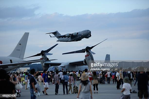 Boeing C17 Globemaster III fly over the Yokota US air base in Tokyo Japan on September 20 2015 Ten Thousands japanese visit Yokota Air Base during...