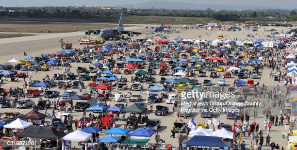 Boeing C17 Globemaster III sits among the booths and cars during Wings Wheels and Rotors at the Los Alamitos Joint Forces Training Base on October 24...