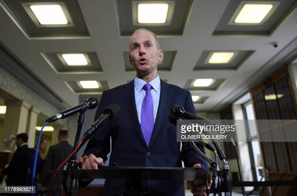 Boeing CEO Dennis Muilenburg makes a statement to the media before testifying at a hearing in front of a congressional lawmakers on Capitol Hill in...