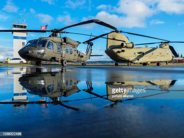 A Boeing CH47 Chinook and a Sikorsky UH60 'Black Hawk' of the United States Army can be seen during a military ceremony at the Storck barracks in...