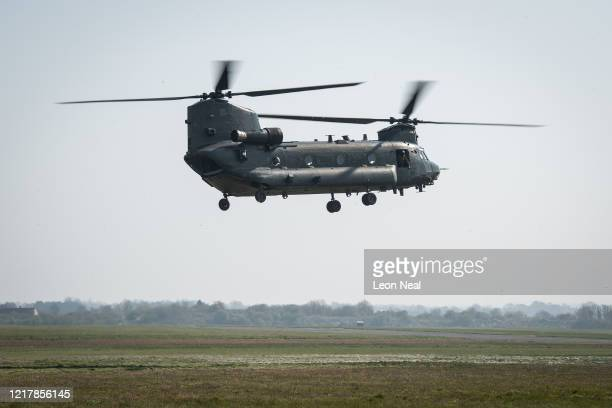 Boeing CH47 Chinook helicopter comes into land as members of the UK Armed Forces work with NHS medical staff and Air Ambulance Service crews at...