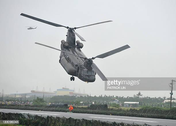 A Boeing CH47 Chinook helicopter of the Taiwanese army is set to fly away after unloading goods during a drill held in Chiatung a remote township in...