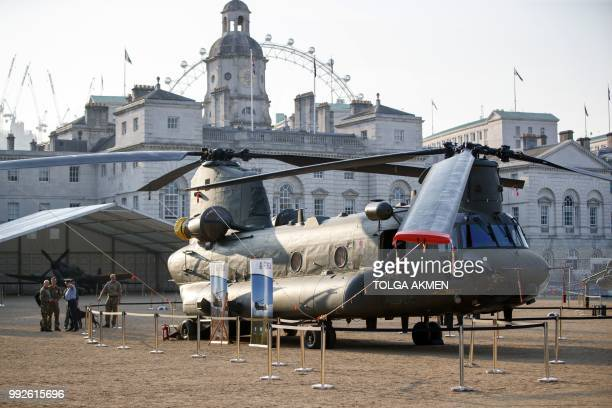 A Boeing Chinook helicopter is displayed during the RAF100 Aircraft Tour at Horse Guards Parade Whitehall in London on July 6 as part of events...