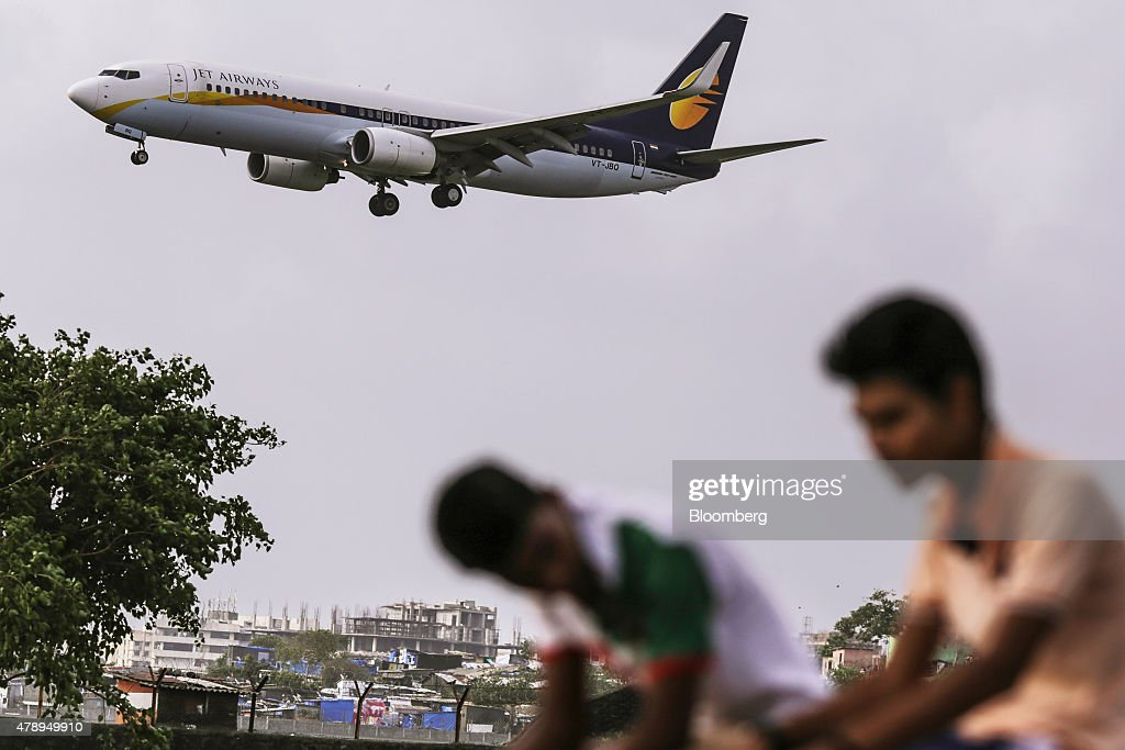 A Boeing Co. 737 aircraft operated by Jet Airways India Ltd. approaches to land at Chhatrapati Shivaji International Airport in Mumbai, India, on Saturday, June 27, 2015. Jet Airways is India's Second biggest airline by market share according to the Indian Aviation Ministry. Photographer: Dhiraj Singh/Bloomberg via Getty Images