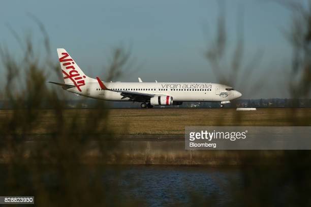 A Boeing Co 737 aircraft operated by Virgin Australia Holdings Ltd taxis at Sydney Airport in Sydney Australia on Thursday Aug 10 2017 Virgin...