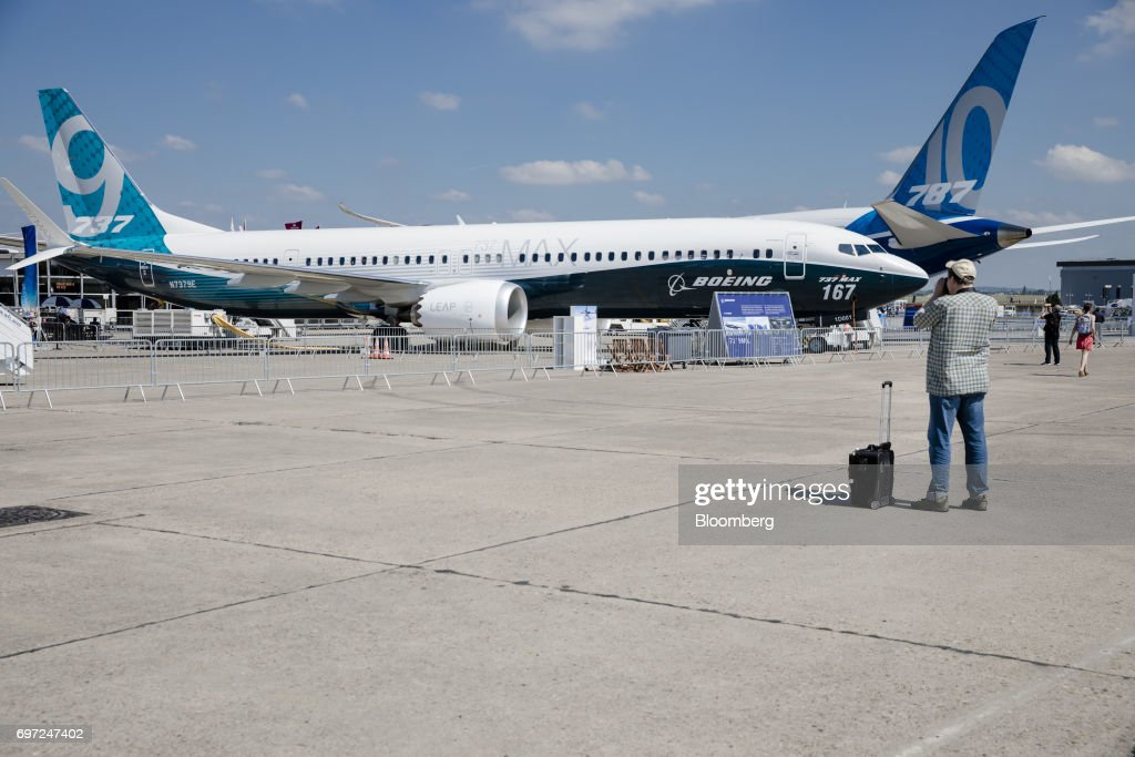 A Boeing Co. 737 Max 9 aircraft stands in front of a Boeing 787-10 passenger jet stands ahead of the 53rd International Paris Air Show at Le Bourget, in Paris, France, on Sunday, June 18, 2017. The show is the world's largest aviation and space industry exhibition and runs from June 19-25. Photographer: Marlene Awaad/Bloomberg via Getty Images
