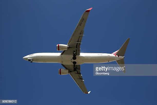 A Boeing Co 737800 aircraft operated by Virgin Australia Holdings Ltd prepares to land at Sydney Airport in Sydney Australia on Monday Feb 8 2016...
