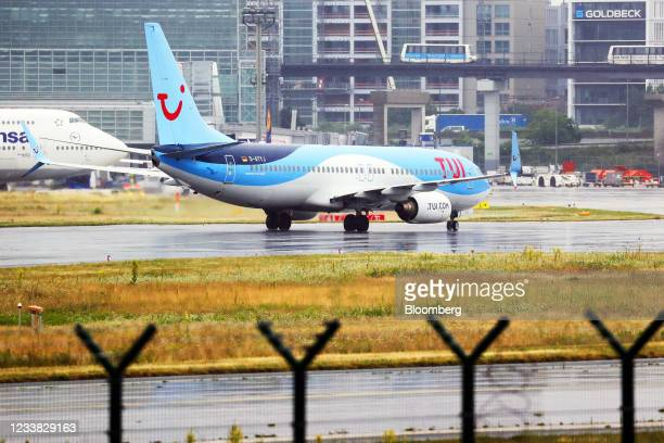 Boeing Co. 737-800 passenger aircraft, operated by TUI AG, taxis at Frankfurt Airport in Frankfurt, Germany, on Tuesday, July 6, 2021. TUI has raised...
