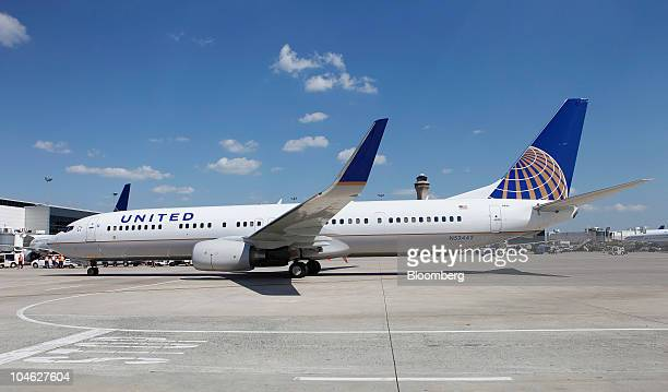 A Boeing Co 737924 extended range jet bearing United Airlines livery and the Continental Airlines logo arrives following the inaugural flight for...