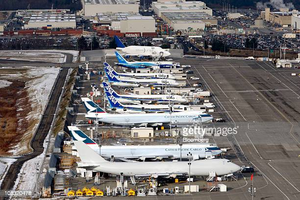 Boeing Co 747 Dreamliners with the livery of Cathay Pacific Cargo front to back Boeing Co 787 Dreamliners with the livery of All Nippon Airways and a...