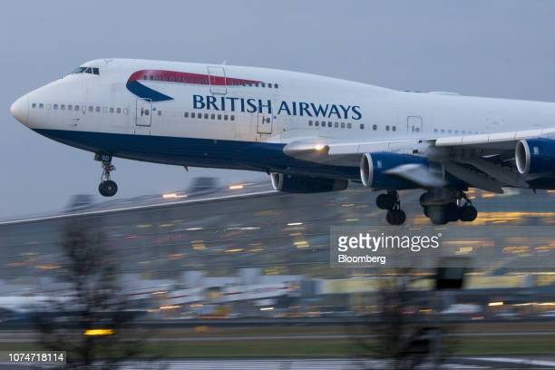 A Boeing Co 747 passenger aircraft operated by British Airways a unit of International Consolidated Airlines Group SA lands at London Heathrow...