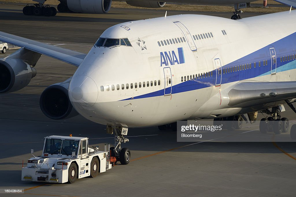 A Boeing Co. 747-400 aircraft operated by All Nippon Airways Co. (ANA) is towed on the tarmac at Haneda Airport in Tokyo, Japan, on Wednesday, Jan. 30, 2013. ANA has canceled a total of 784 flights, affecting 74,200 passengers through Feb. 12, since a Jan. 16 incident that led to the global grounding of Boeing Co. 787s, according to figures from the company. Photographer: Akio Kon/Bloomberg via Getty Images