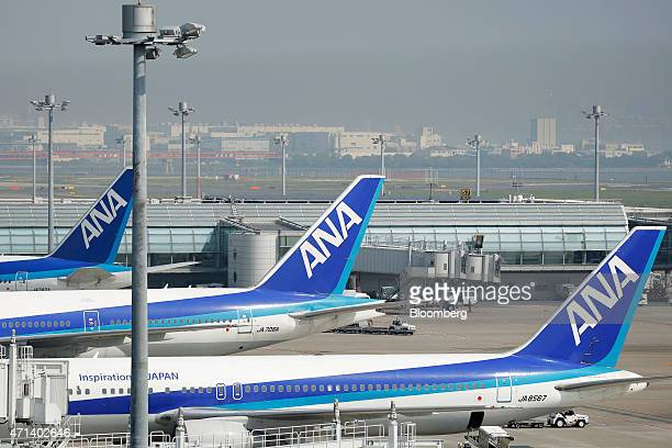 A Boeing Co 767300 aircraft front and other aircraft operated by All Nippon Airways Co sit parked at Haneda Airport in Tokyo Japan on Tuesday April...