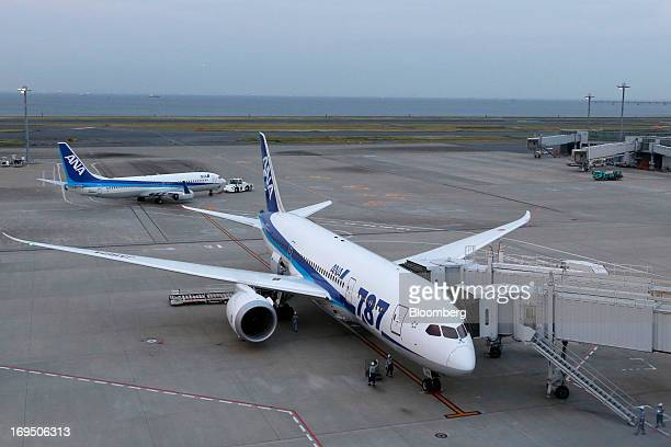 A Boeing Co 787 Dreamliner aircraft operated by All Nippon Airways Co bottom stands parked at Haneda Airport in Tokyo Japan on Sunday May 26 2013 ANA...