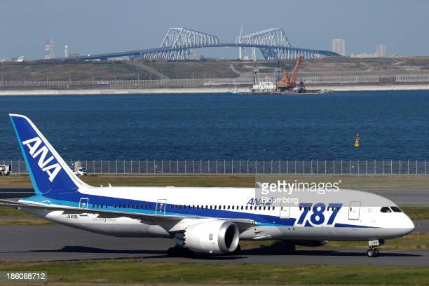 A Boeing Co 787 Dreamliner aircraft operated by All Nippon Airways Co taxis on the tarmac at Haneda Airport in Tokyo Japan on Sunday Oct 27 2013 ANA...