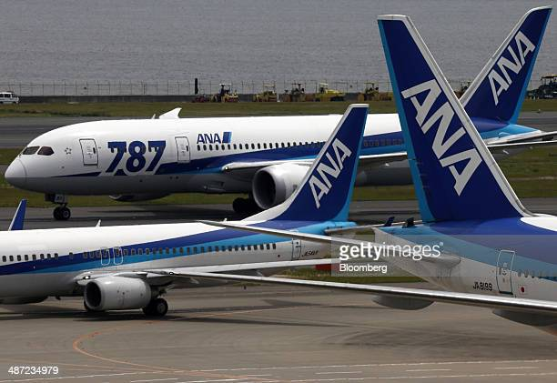 A Boeing Co 787 Dreamliner aircraft operated by All Nippon Airways Co top taxies past other ANA aircraft at Haneda Airport in Tokyo Japan on Monday...