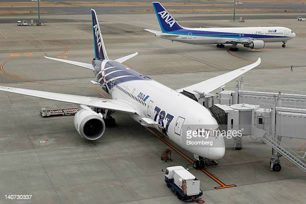 A Boeing Co 787 Dreamliner airplane for All Nippon Airways Co left is parked at Haneda Airport in Tokyo Japan on Sunday March 4 2012 All Nippon...