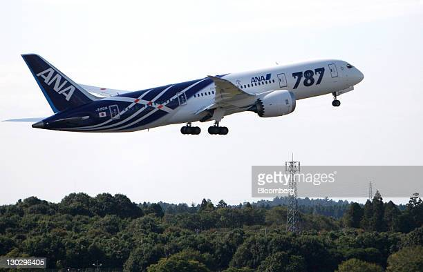 A Boeing Co 787 Dreamliner airplane for All Nippon Airways Co takes off at Narita Airport in Narita City Chiba Prefecture Japan on Wednesday Oct 26...