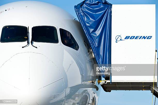 A Boeing Co 787 Dreamliner awaits final details to be completed before delivery to launch customer All Nippon Airways Co at the company's facility in...