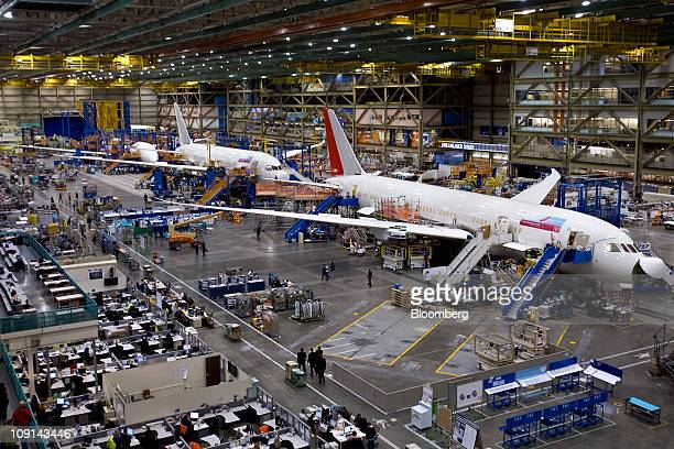 Boeing Co 787 Dreamliner jets for Air India right and Japan Airlines Corp sit on the assembly line at Boeing's manufacturing facility in Everett...
