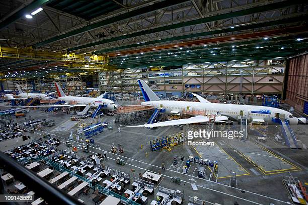 Boeing Co 787 Dreamliner jets for All Nippon Airways right Air India center and Japan Airlines Corp sit on the assembly line at the company's...