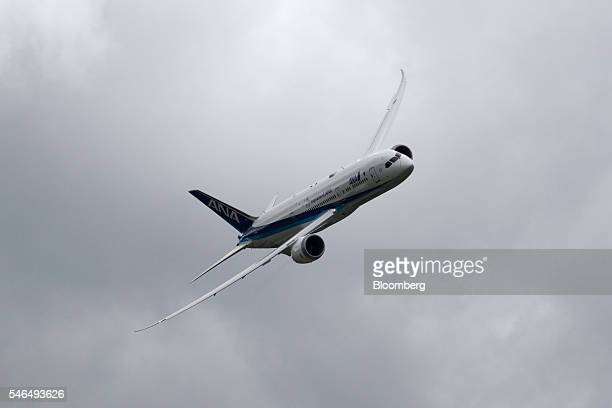 A Boeing Co 787 dreamliner passenger aircraft operated by All Nippon Airways Co performs a flying display on the second day of the Farnborough...