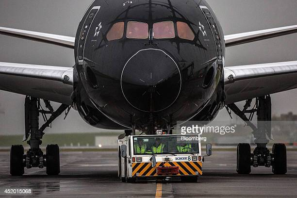 A Boeing Co 7879 Dreamliner aircraft operated by Air New Zealand Ltd is towed across the tarmac by a tractor after touching down at Auckland...
