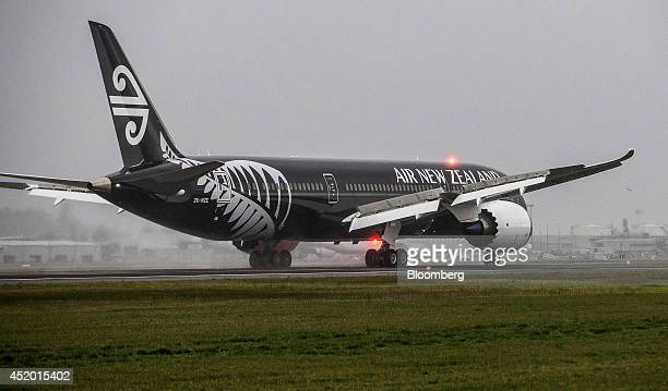A Boeing Co 7879 Dreamliner aircraft operated by Air New Zealand Ltd touches down at Auckland International Airport in Auckland New Zealand on Friday...