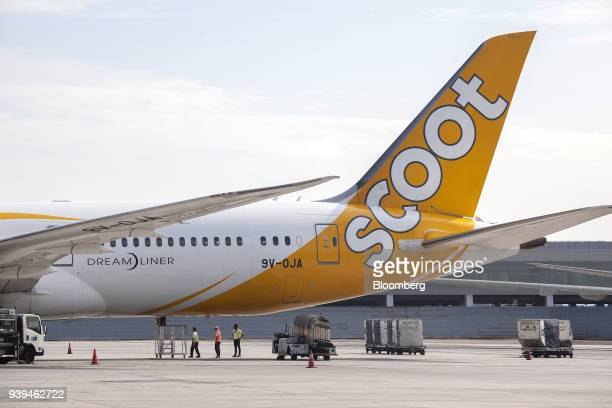 A Boeing Co 7879 Dreamliner aircraft operated by Scoot Pte a unit of Singapore Airlines Ltd sits on the tarmac at Changi Airport in Singapore on...