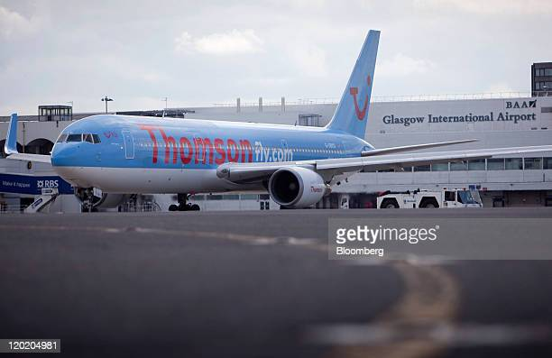 Boeing Co. Aircraft, operated by Thomson, part of the TUI AG group, sits on the tarmac at BAA Ltd.'s Glasgow airport in Glasgow, Scotland, on Friday,...