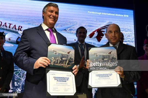 Boeing Commercial Airplanes CEO Kevin McAllister and Qatar Airways CEO Akbar Al Baker display the contracts as they announce the purchase of planes...