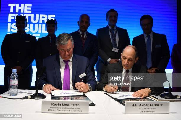 Boeing Commercial Airplanes CEO Kevin McAllister and Qatar Airways CEO Akbar Al Baker sign the contracts as they announce the purchase of planes for...