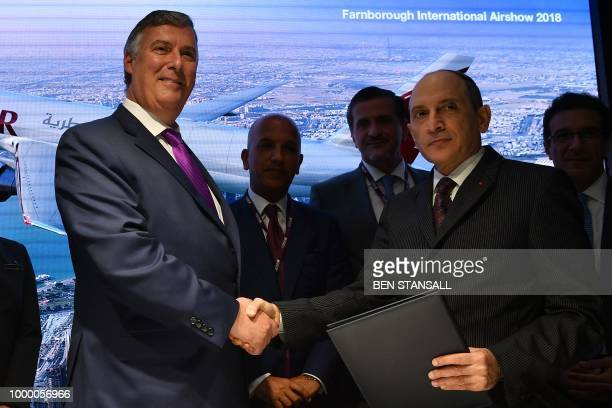 Boeing Commercial Airplanes CEO Kevin McAllister and Qatar Airways CEO Akbar Al Baker shake hands as they announce the purchase of planes for Qatar...