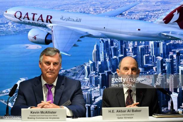 Boeing Commercial Airplanes CEO Kevin McAllister looks on as Qatar Airways CEO Akbar Al Baker announces the purchase of planes for their cargo...