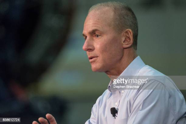 Boeing Company CEO Dennis Muilenburg speaks during a town hall with House Speaker Paul Ryan and Boeing employees at the company's plant on August 24...