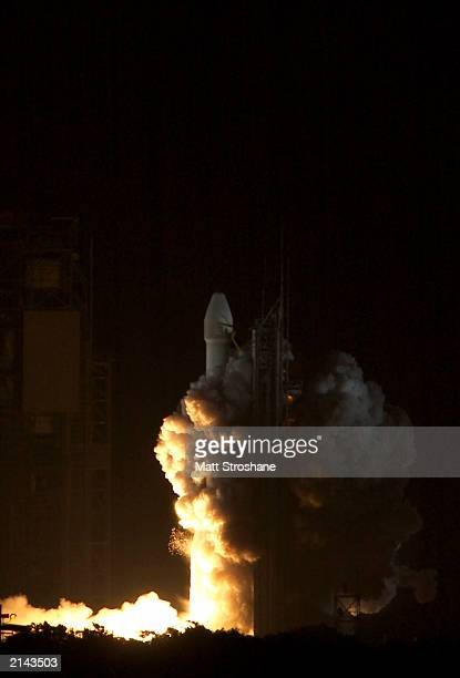 """Boeing Delta II rocket, carrying the second Mars Exploration Rover """"Opportunity,"""" lifts off the pad at launch complex 17B July 7, 2003 at the Cape..."""