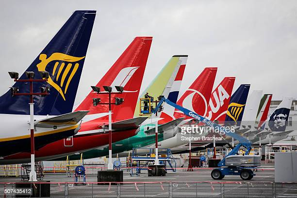 Boeing employee navigates a lift among 737 airliners on the flight line at Boeing Field on January 29 2016 in Seattle Washington The 737 is Boeing's...