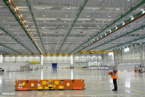 Boeing employee operates an automated guided vehicle which is used for carrying wing parts at the 777X Composite Wing Center on October 23 2017 in...