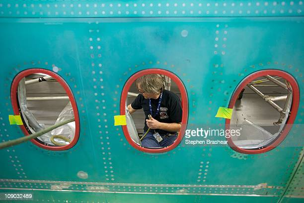 Boeing employee works in the fuselage section of the 7478 Intercontinental airplane at the Boeing factory February 12 2011 in Everett Washington...