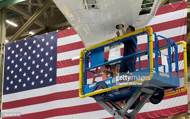 Boeing employee works on the wing of a Boeing 787 Dreamliner June 13 2012 at the Boeing Factory in Everett Washington