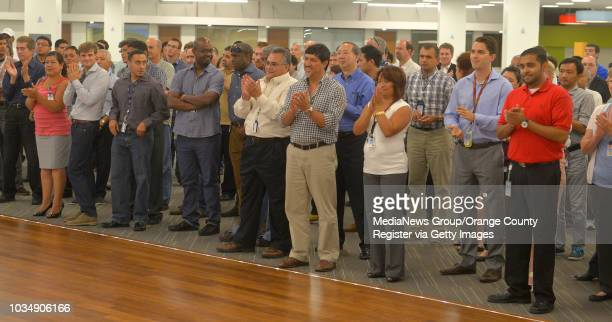 Boeing employees applaud as officials open their new customer support operations center at their facility in Seal Beach CA on Friday September 12...