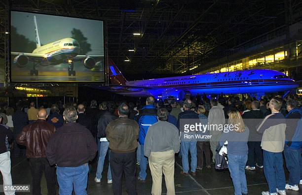 Boeing employees attend a ceremony marking the completion of the 757 commercial airplane program at the company's plant October 28 2004 in Renton...