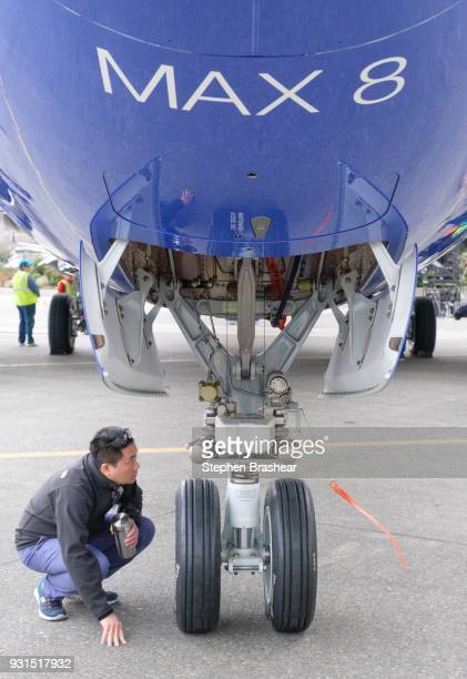 Boeing employees checks out the landing gear of a 737 MAX 8 after a celebration of the 10000th 737 aircraft at the company's factory on March 13 2018...