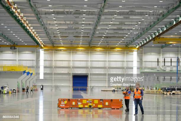 Boeing employees operate a automated guided vehicle which is used for carrying wing parts at the 777X Composite Wing Center on October 23 2017 in...