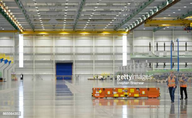 Boeing employees operate an automated guided vehicle which is used for carrying wing parts at the company's factory on October 23 2017 in Everett...