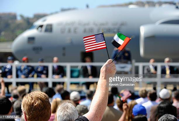 Boeing employees wave United States and United Arab Emirates flags during a handing off ceremony of the first of six C17 Globemaster III airlifters...